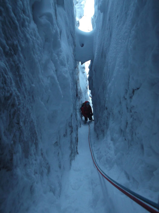 Guiding Deep Cut Chimney, a mixed climb in the Cairngorms