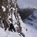 Nick climbing in the sunshine on Eastern Slant during our winter climbing course