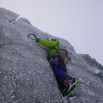 On the off-width chimney of Pinnacle Arete, Ben Nevis