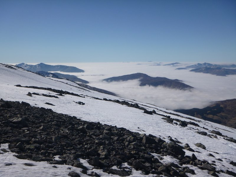 The nunatak-like summits poking out of the sea of cloud.