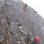 Wet rock climbing at Raven's Crag, Gairloch
