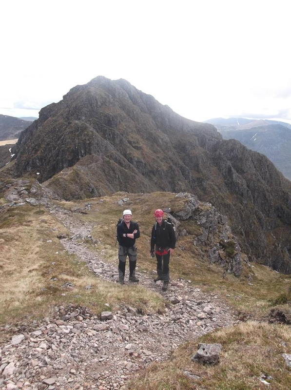 David & David being guided on the Aonach Eagach