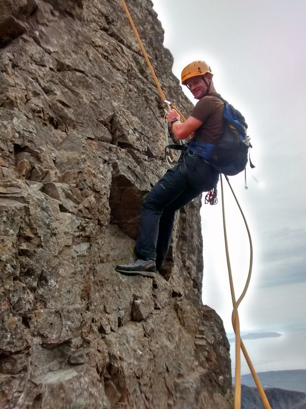 Abseiling off the Inn Pinn during a guided Greater Traverse of the Skye Cuillin Ridge