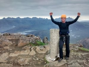 Stu on the summit of Bla Bheinn, having competed a non-stop traverse of the Greater Cuillin Ridge Traverse!