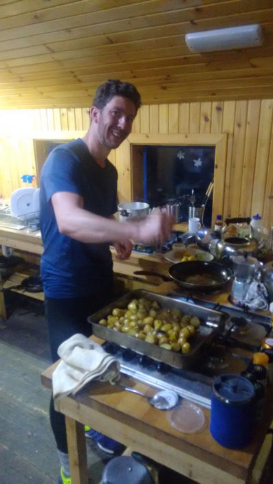 AMI Mountaineering Instructor Stuart Lade cooking on our CIC Hut Week