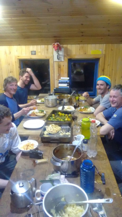 Enjoying another feast in the CIC Hut on our week long winter climbing course