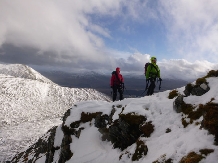Practising moving together on a winter mountaineering course in Scotland
