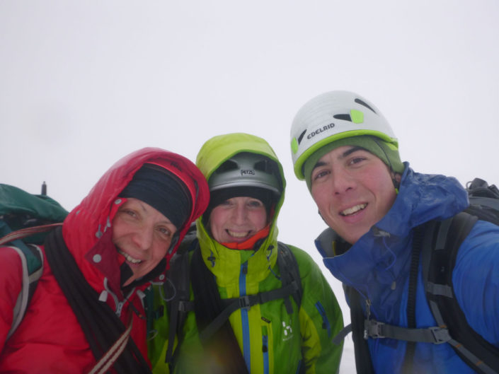 On the summit of Beinn a'Chaorainn on a winter mountaineering course