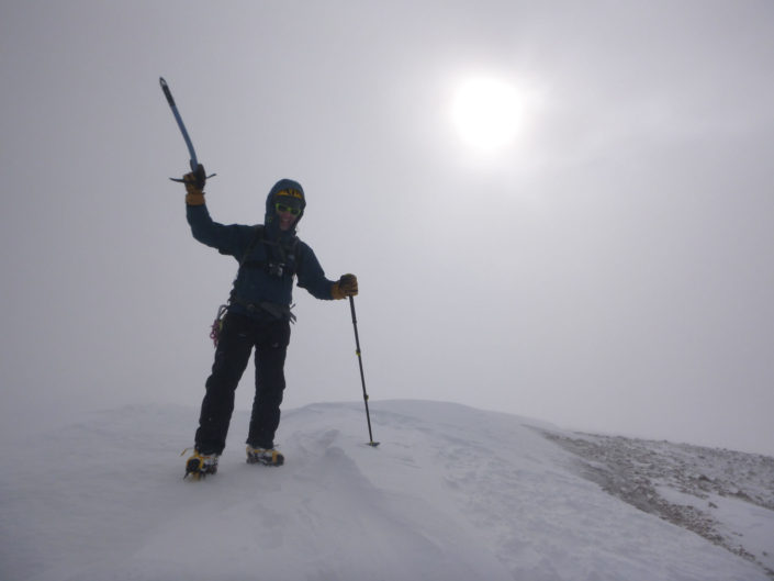 Reaching the summit after a winter climb.