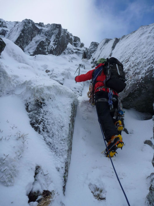 Leading on Daim Buttress on a winter climbing course