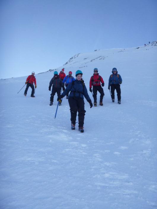 Concentrating on walking downhill in crampons