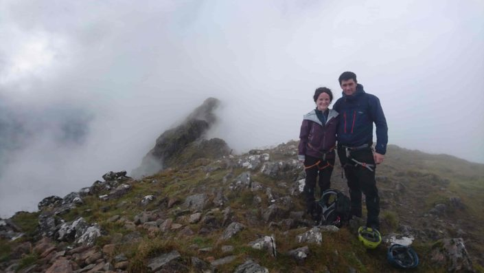 Happy clients being guided on the Aonach Eagach