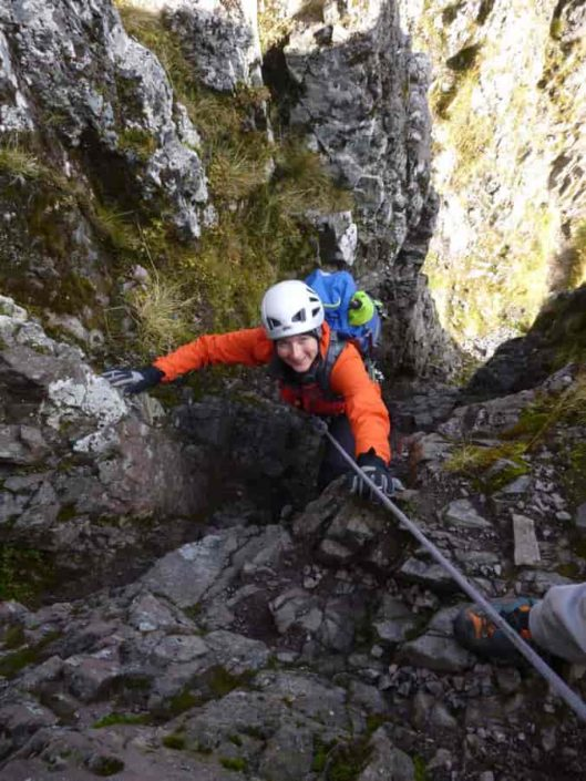 Happy client being guided on the Aonach Eagach